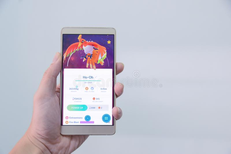 Pokemon gaat de werkgever van de gebeurtenis ho-oh inval catched door pokemontrainer in de gebeurtenis van Japan Versie legendari royalty-vrije stock foto