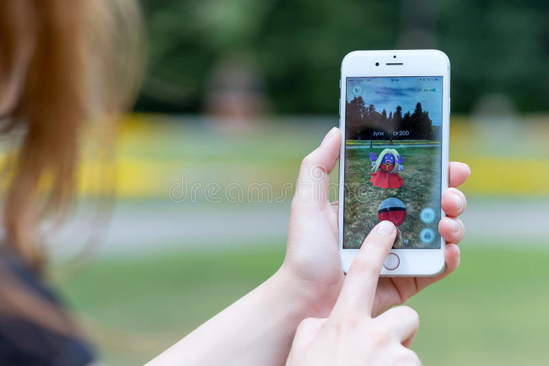 Pokemon Go app with Jynx pokemon catching on Apple iPhone 6S. Varna, Bulgaria - Jul 20, 2016: Nintendo Pokemon Go augmented reality mobile application game with royalty free stock image