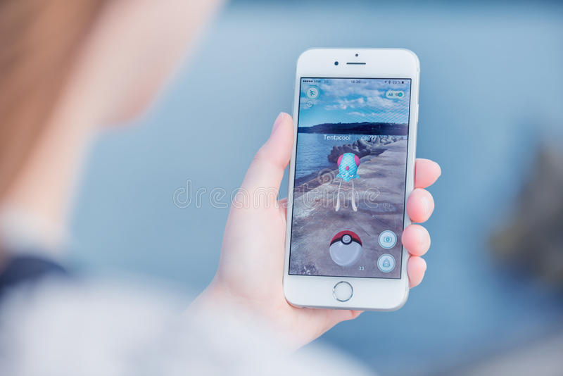 Pokemon Go app with Tentacool pokemon catching on Apple iPhone 6. Varna, Bulgaria - Jul 19, 2016: Nintendo Pokemon Go augmented reality mobile application game royalty free stock photography