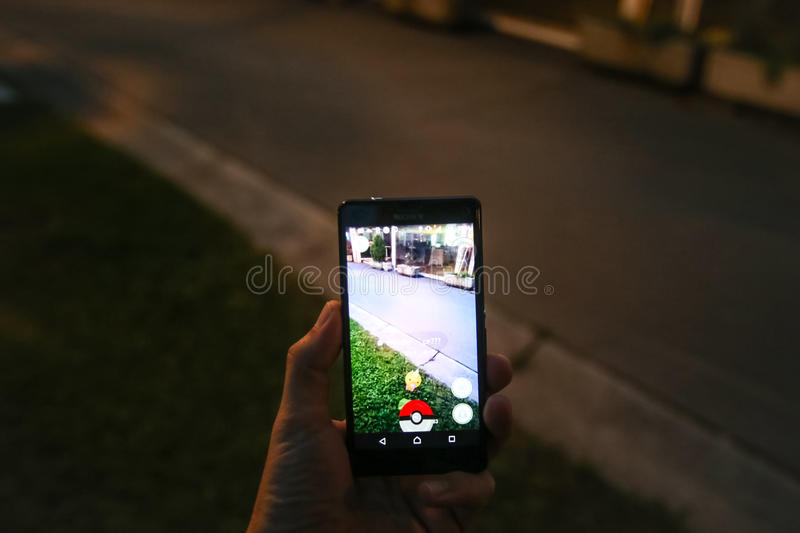Pokemon Go App. VELIKA GORICA, CROATIA- JULY 15, 2016 : Gamer finds a pokemon on the street using a smartphone to play Pokemon Go. Pokemon Go is a free-to-play royalty free stock photos