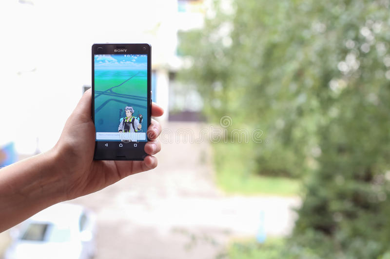 Pokemon Go App. VELIKA GORICA, CROATIA- JULY 15, 2016 : A gamer using a smartphone to play Pokemon Go in Velika Gorica, Croatia. Pokemon Go is a free-to-play royalty free stock images