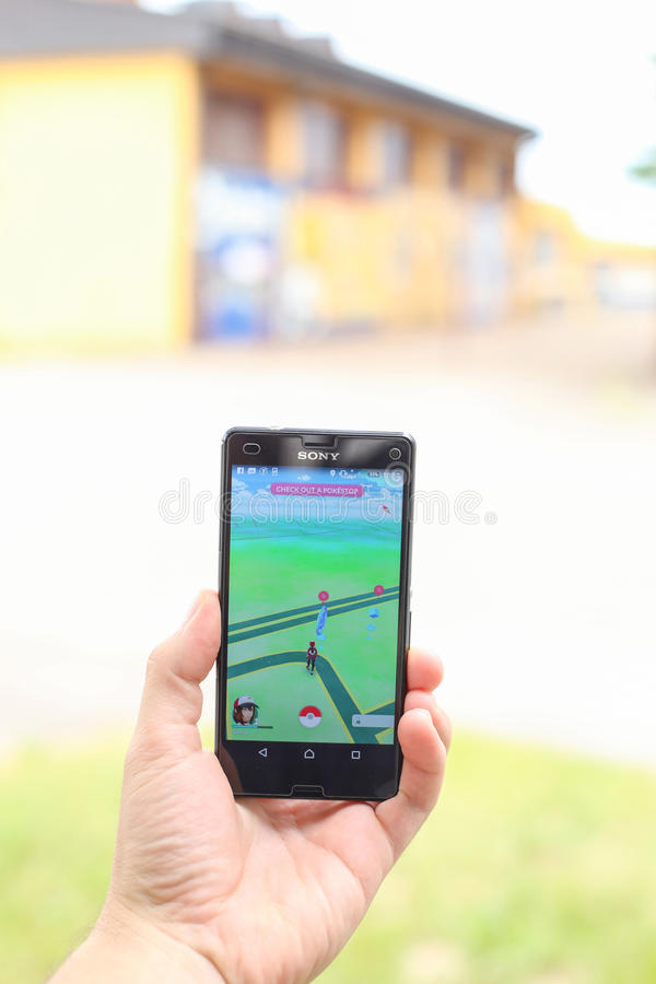 Pokemon Go App. VELIKA GORICA, CROATIA- JULY 15, 2016 : A gamer using a smartphone to play Pokemon Go in Velika Gorica, Croatia. Pokemon Go is a free-to-play royalty free stock photo