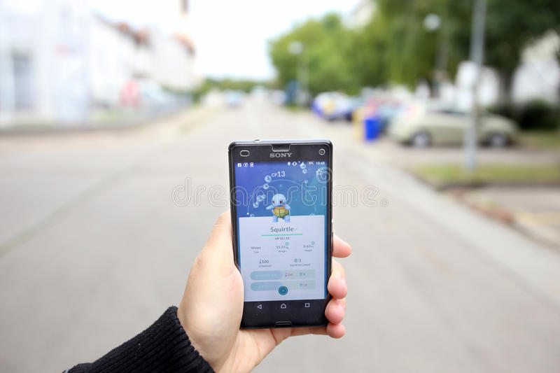 Pokemon Go App. VELIKA GORICA, CROATIA- JULY 15, 2016 : A gamer using a smartphone to play Pokemon Go in Velika Gorica, Croatia. Pokemon Go is a free-to-play stock image