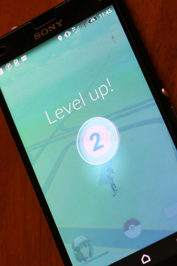 Pokemon Go App. VELIKA GORICA, CROATIA- JULY 15, 2016 : Level up on a Pokemon Go game on the smartphone. Pokemon Go is a free-to-play augmented reality mobile stock images