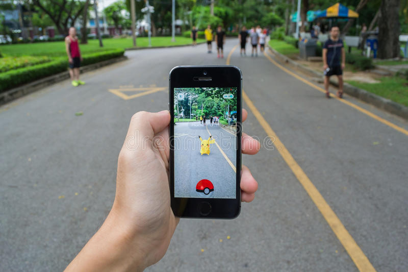 Pokemon Go. Bangkok, Thailand - July 22, 2016 : Pokemon Go is a new augmented reality game which lets you walk in the real world to catch the Pokemon royalty free stock image