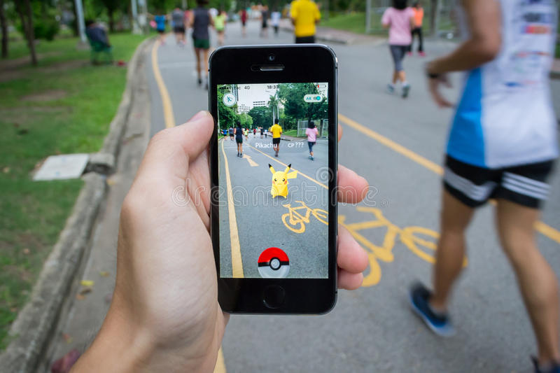 Pokemon Go. Bangkok, Thailand - July 22, 2016 : Pokemon Go is a new augmented reality game which lets you walk in the real world to catch the Pokemon royalty free stock photo