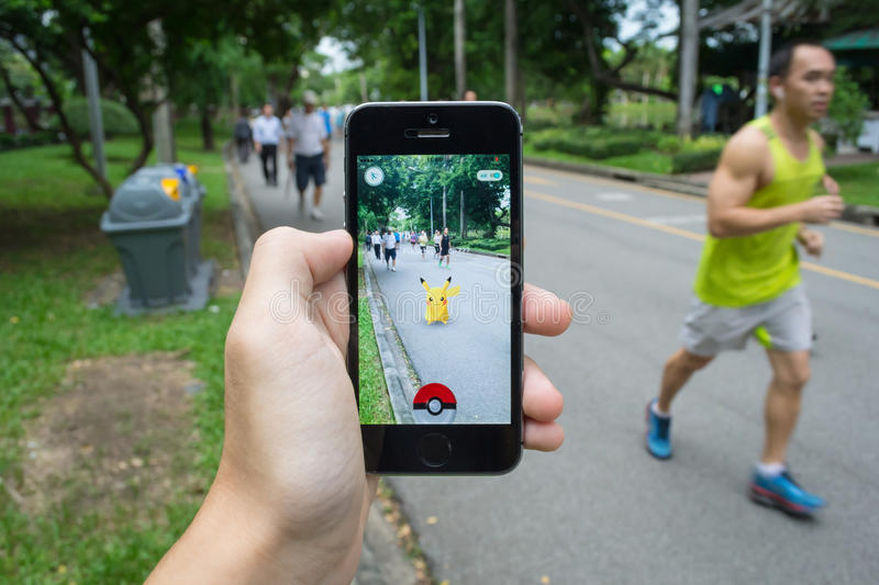Pokemon Go. Bangkok, Thailand - July 22, 2016 : Pikachu was found at a park in Pokemon Go, a new augmented reality game which lets you walk in the real world to stock image
