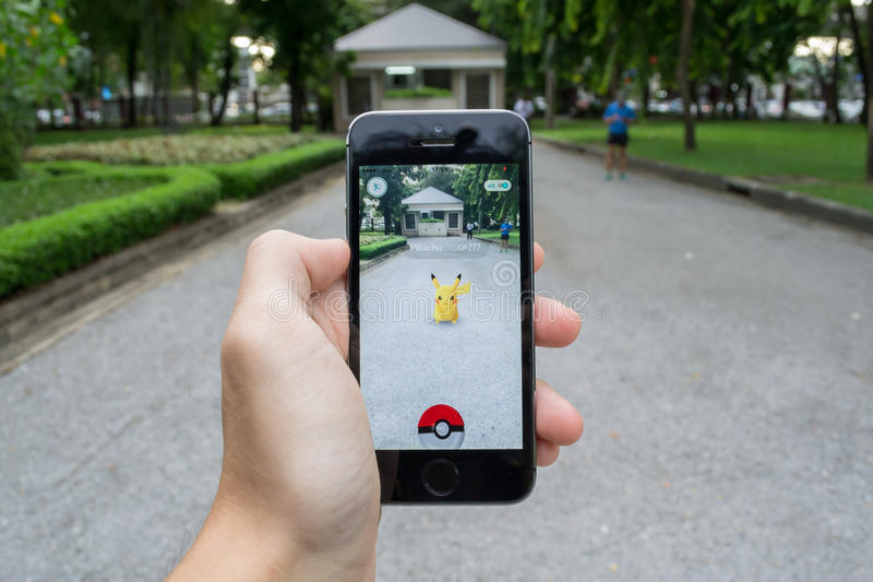 Pokemon Go. Bangkok, Thailand - July 22, 2016 : Pikachu was found at a park in Pokemon Go, a new augmented reality game which lets you walk in the real world to royalty free stock image