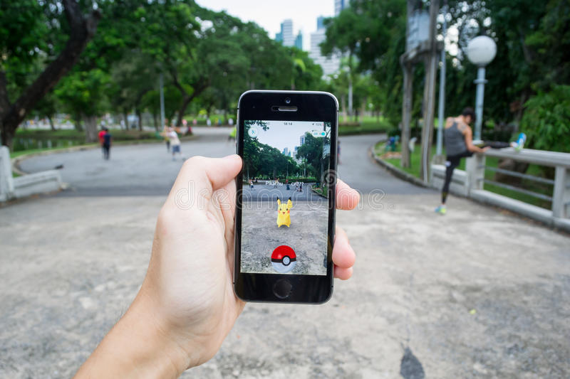 Pokemon Go. Bangkok, Thailand - July 22, 2016 : Pikachu was found at a park in Pokemon Go, a new augmented reality game which lets you walk in the real world to royalty free stock images