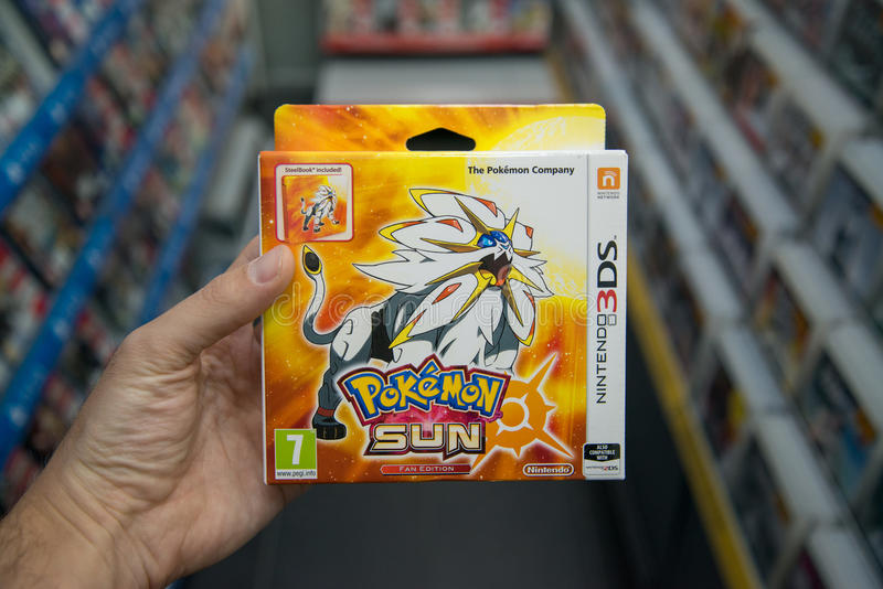 Pokemon Sun videogame. Bratislava, Slovakia, circa april 2017: Man holding Pokemon Sun videogame on Nintendo 3DS console in store stock photo