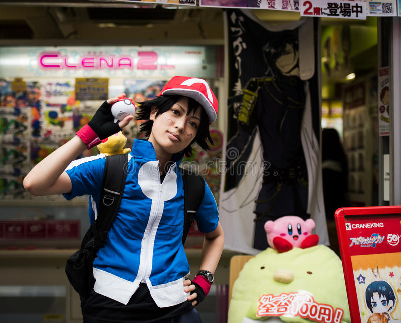 Pokemon Trainer. Young Japanese girl dressed up as Ash, the popular trainer in the original Nintendo Pokemon game. His role in the game is different in the new royalty free stock photos