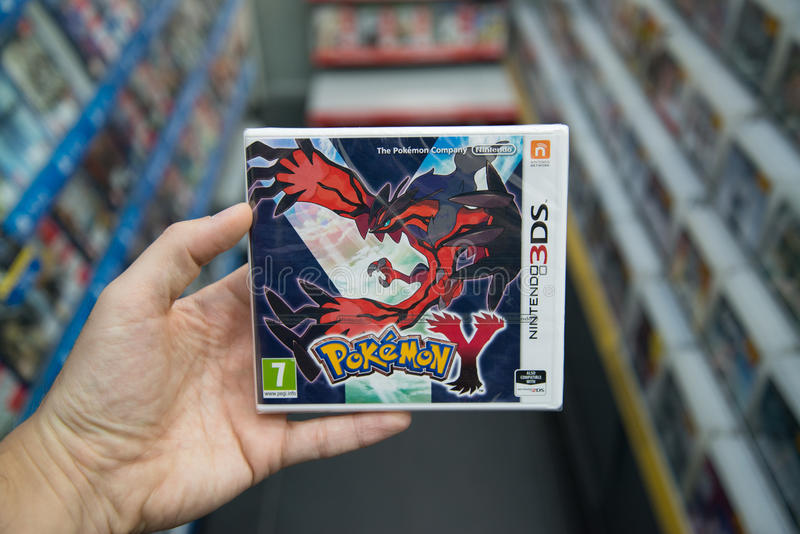 Pokemon Y videogame. Bratislava, Slovakia, circa april 2017: Man holding Pokemon Y videogame on Nintendo 3DS console in store royalty free stock image