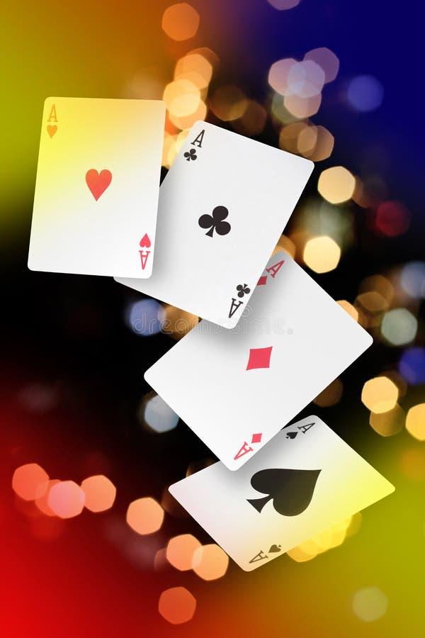 Poker of aces em um fundo com luzes de fundo com espaço de cópia para o seu texto fotografia de stock royalty free