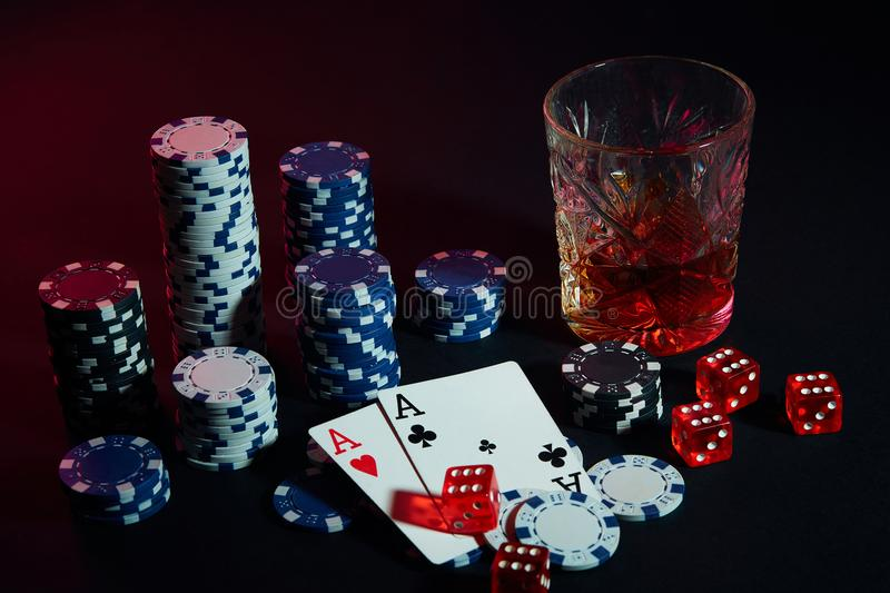 Poker cards with cubes are beautifully placed on the table, against the background of poker chips stock images