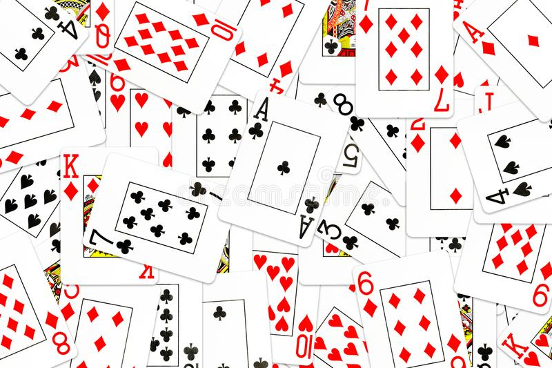 Poker cards mixed on the table. With copyspace royalty free illustration