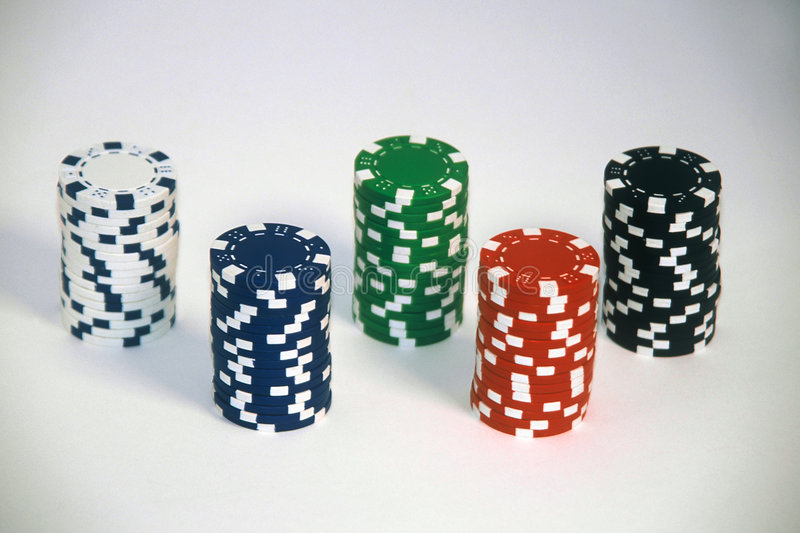 Poker Chips. Five stacks of poker chips on a white background royalty free stock photography