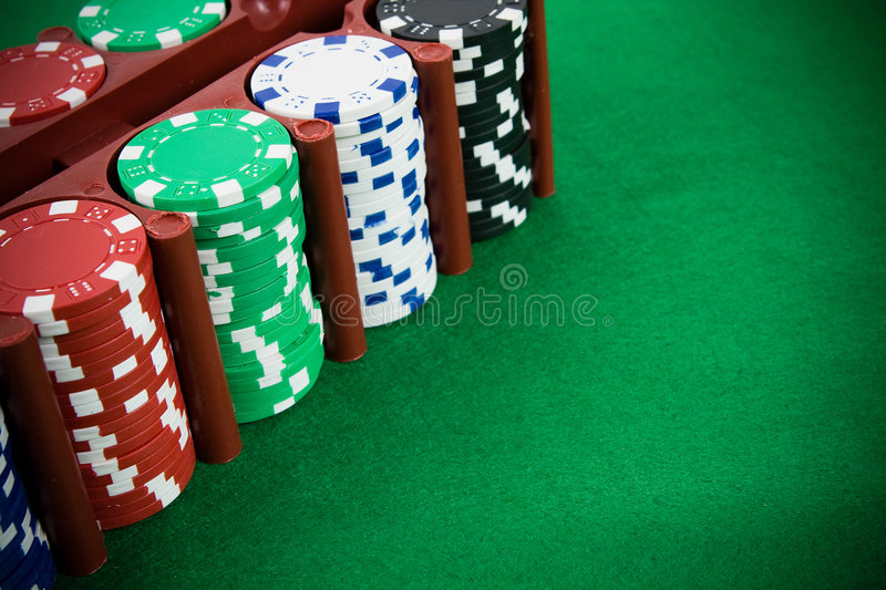 Poker chips in a box royalty free stock photography