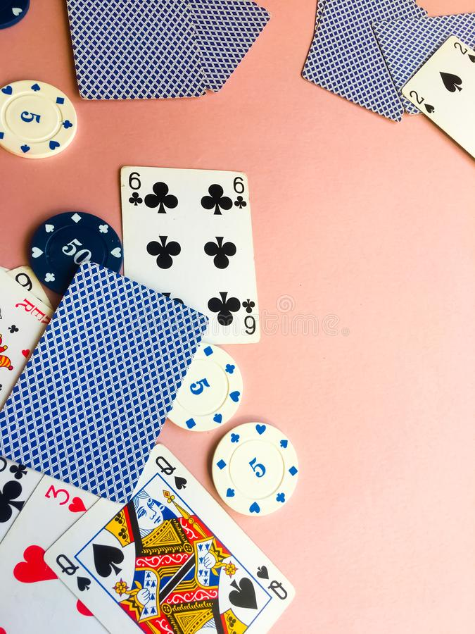 Poker chips and cards on a pink background. The game of poker. Gambling stock illustration