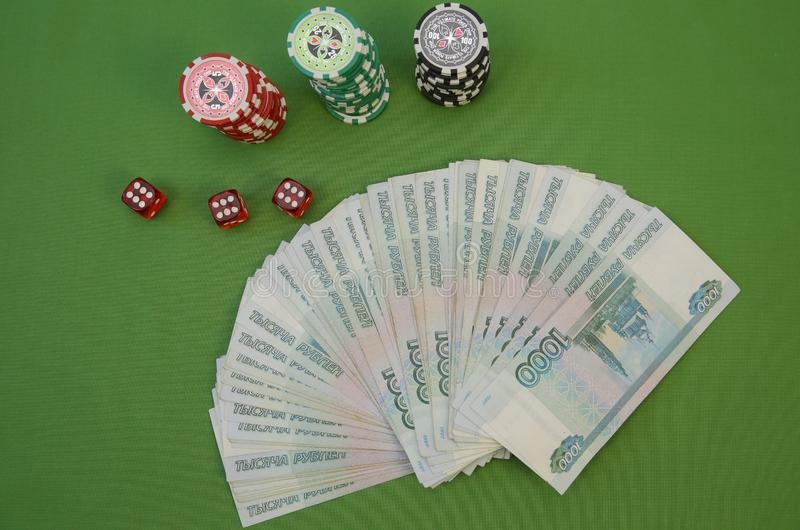 Poker chips and cash on a green background. Business and finance concept. Flat lay. Top view. royalty free stock photo