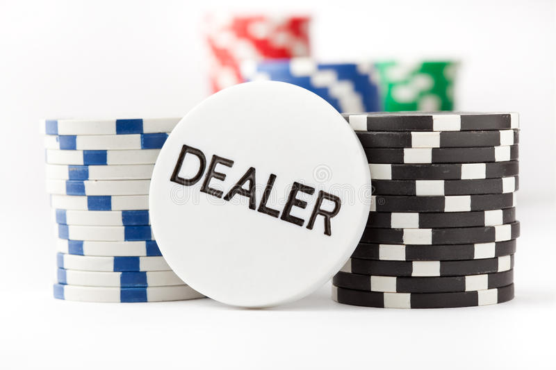Poker chips and dealer button. On white background royalty free stock image