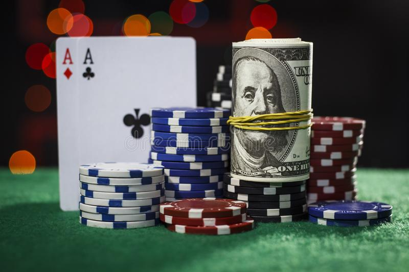 Poker chips, dollars and a pair of aces stock image