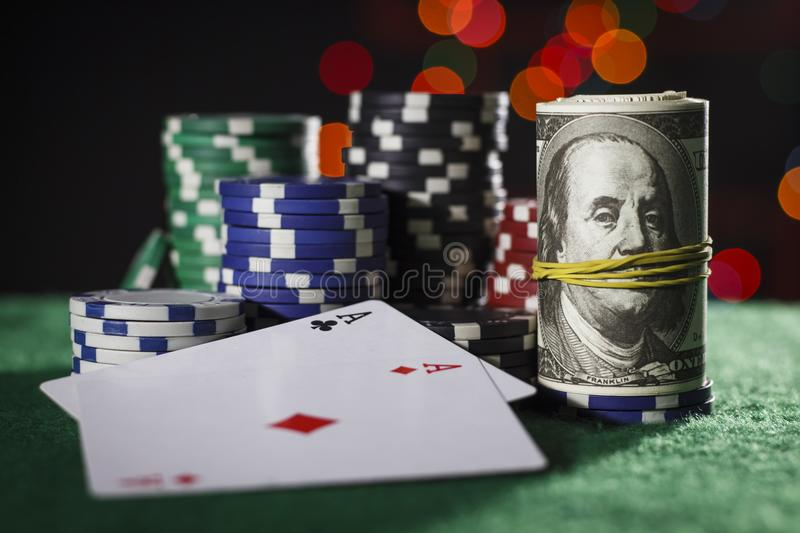 Poker chips, dollars and a pair of aces stock photo