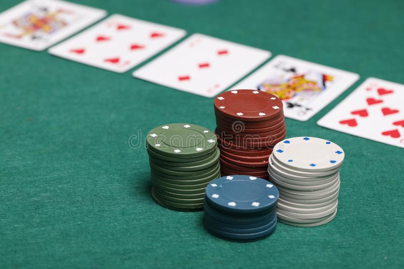 Poker chips on a poker table royalty free stock photography