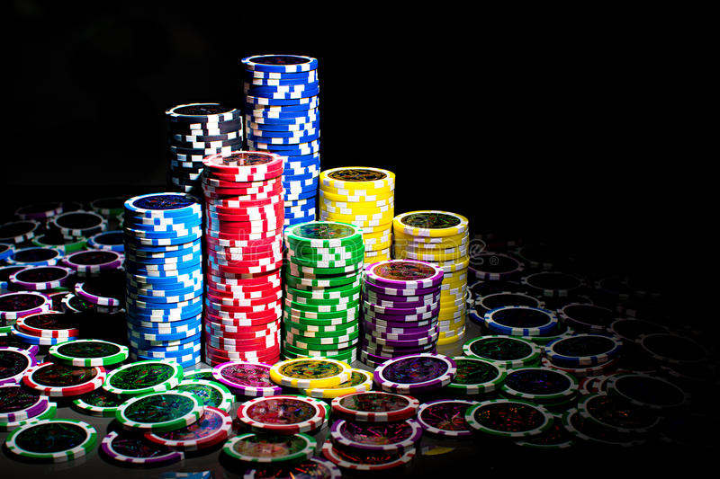 Poker chips. There are columns of poker chips. Everything what you need for fun of a game stock photography