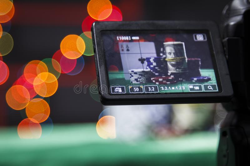 Poker chips in the viewfinder on camera royalty free stock images