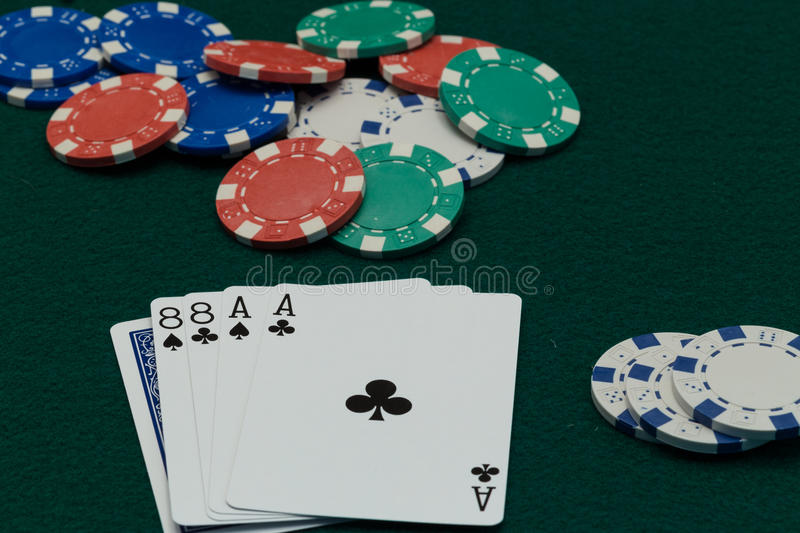 Poker Dead Mans Hand with chips. Dead man hand, the poker cards supposedly held by Wild Bill Hickok at moment of his murder royalty free stock images