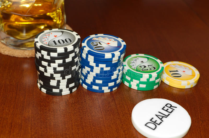 Poker Dealer Button and Casino Tokens Horizontal. With a Cool Drink stock photos