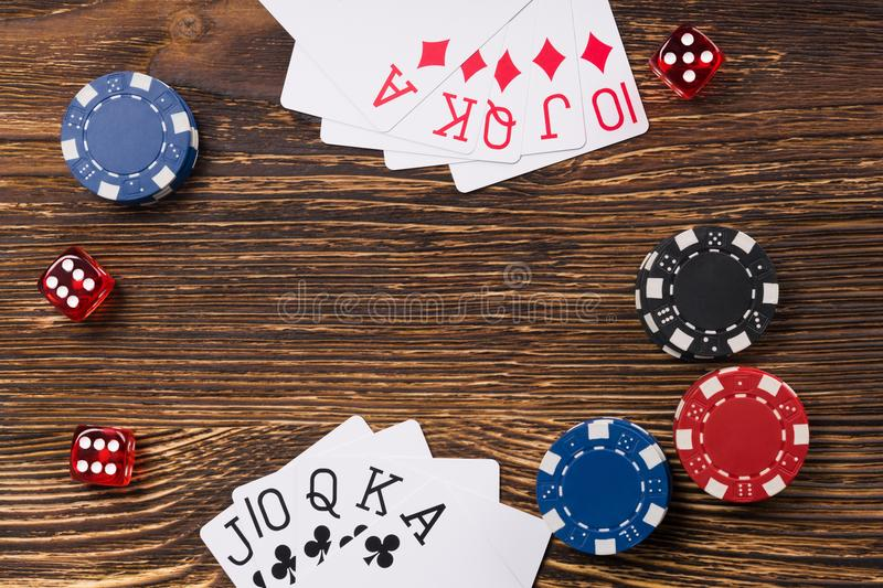 Poker game on a wooden table, cards with chips and dice of poker stock images