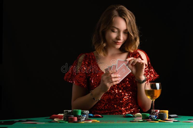 Poker girl wins a jackpot in a casino. On a black background. Winning in a casino royalty free stock images