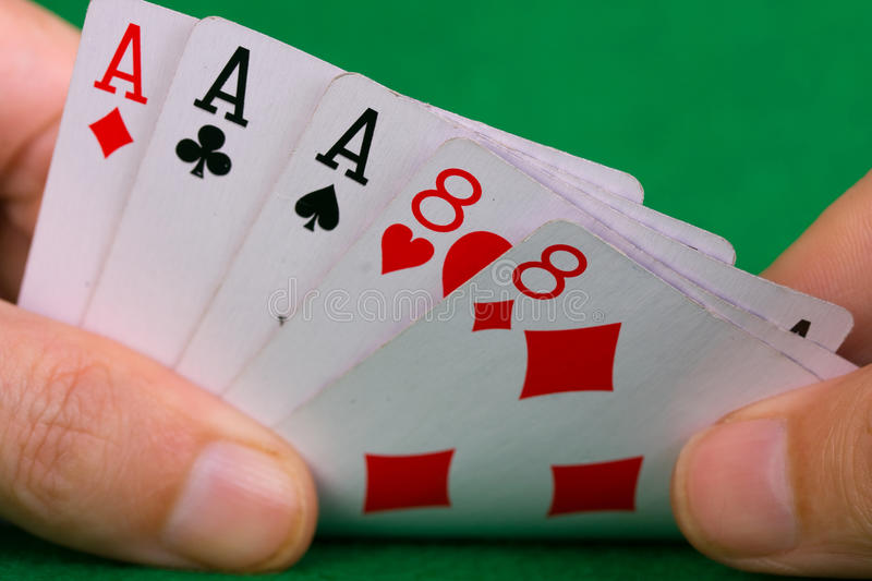 Poker Hand. Showing a full house Aces over eights royalty free stock images
