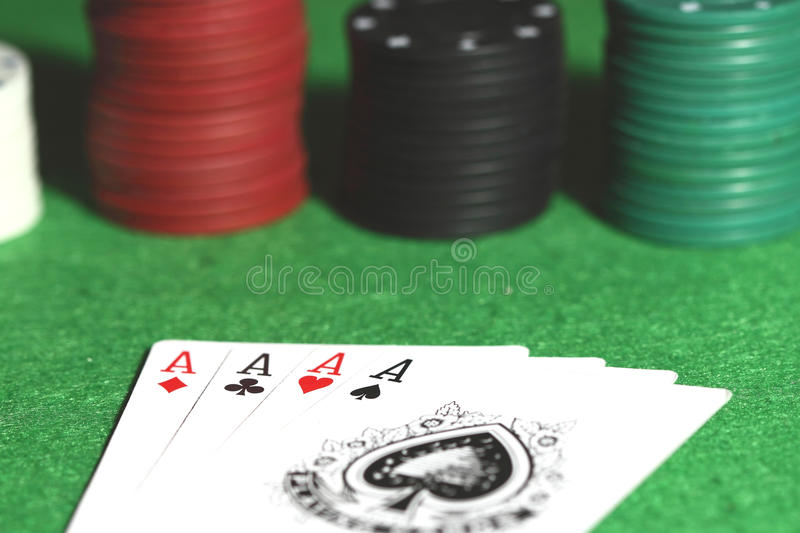 Poker hand. Photograph of a poker hand with chips stock photo