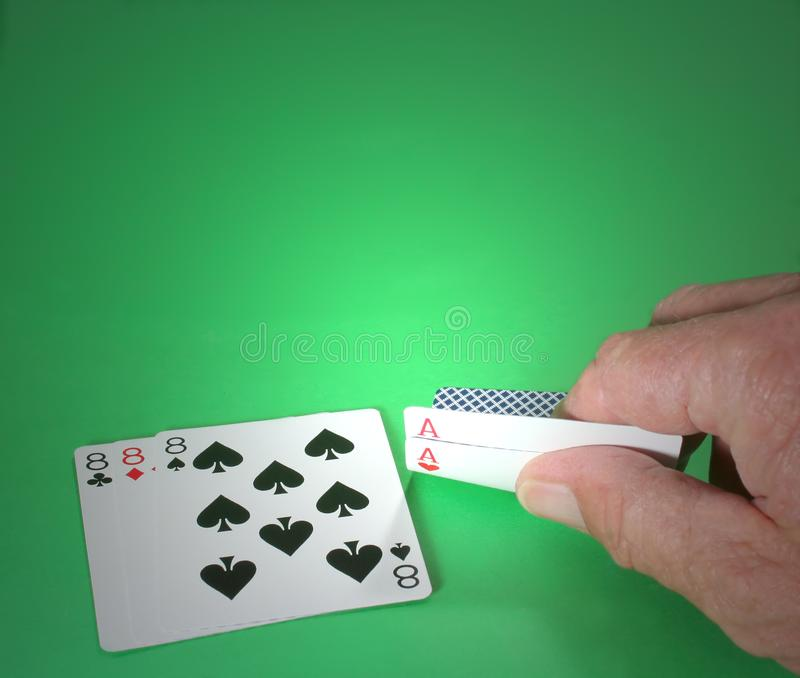 Poker hand with aces and eights stock photo