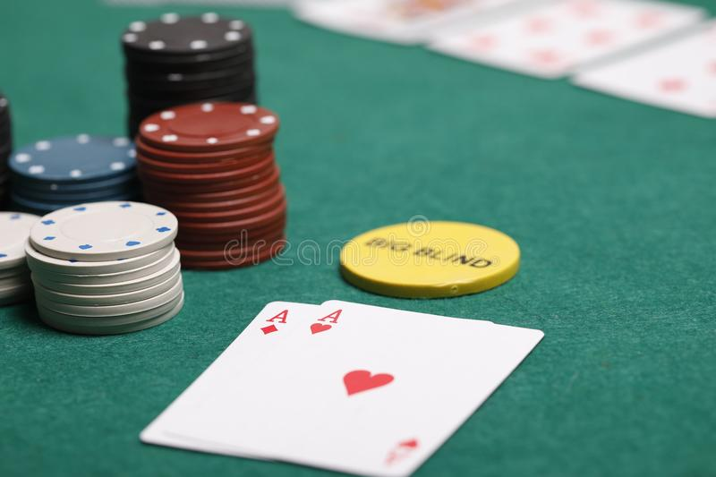 Poker hand with chips on a poker table royalty free stock photography