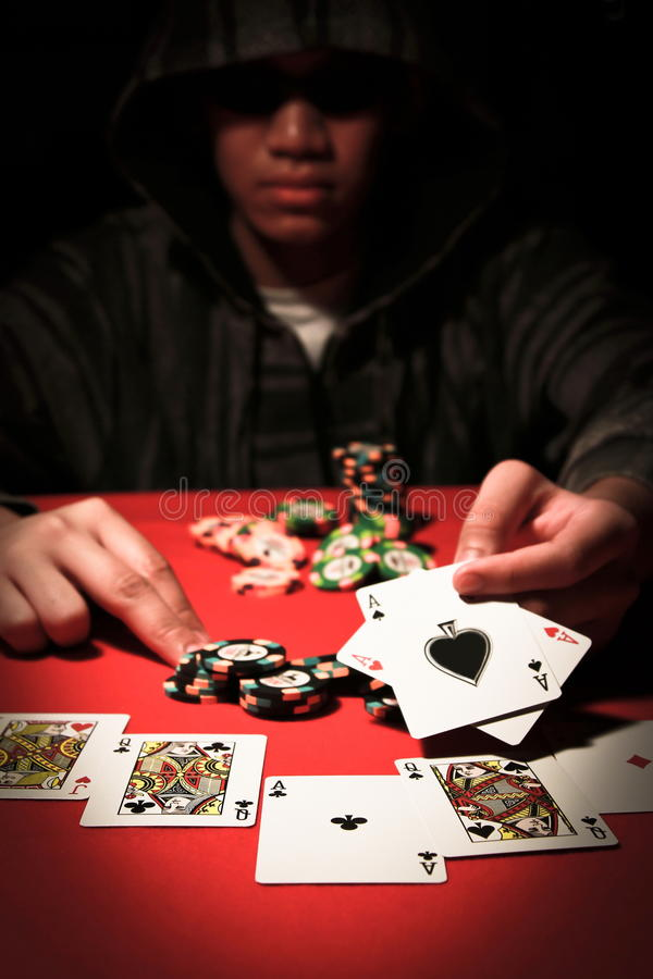 Poker Player. Image of poker player with chips and cards stock photo