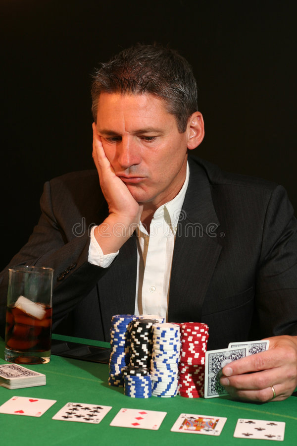 Poker player. Serious poker player contemplating his next move stock images