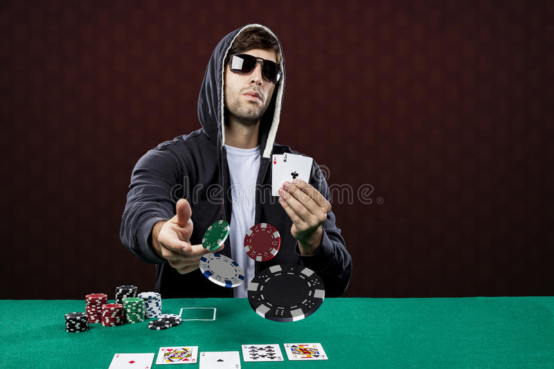 Poker player. On a red background stock images