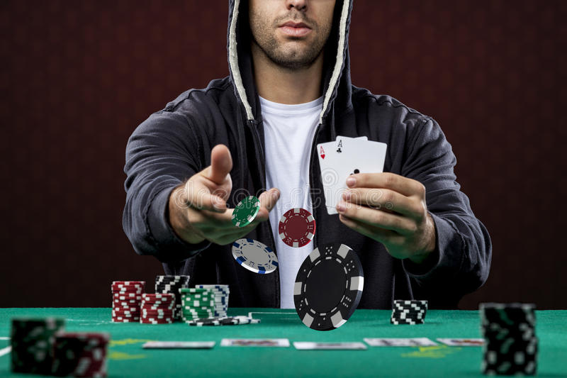 Poker player. On a red background, throwing poker chips stock images