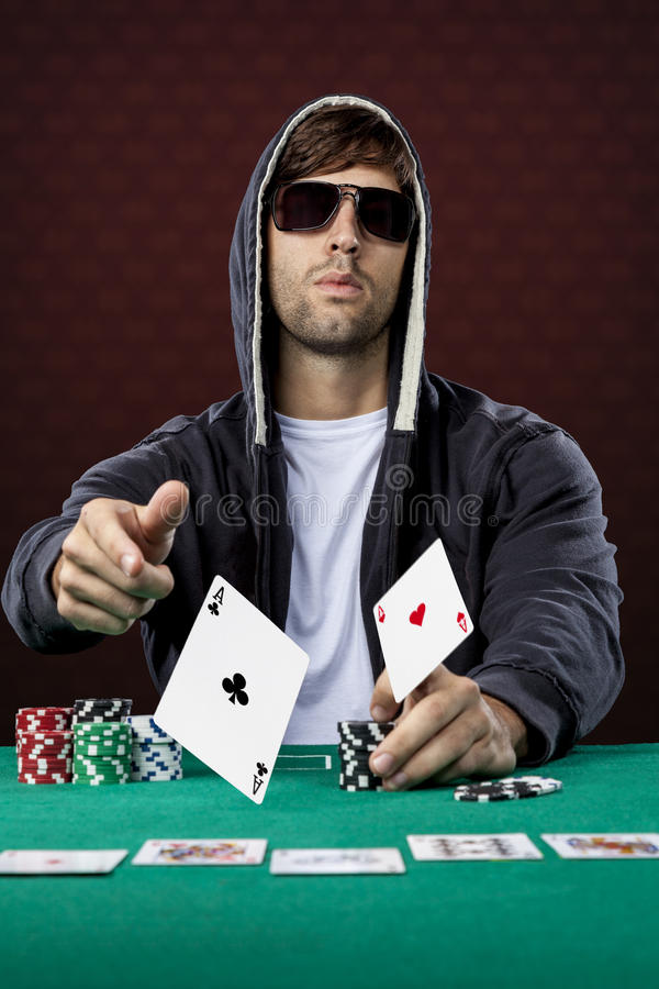 Poker player. On a red background, throwing two ace cards royalty free stock photos