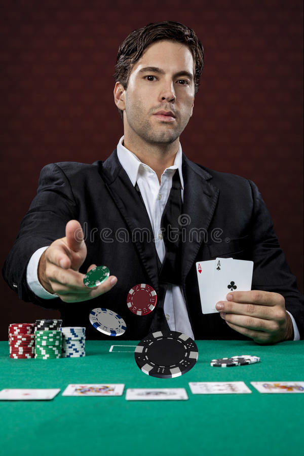 Poker player. On a red background, throwing poker chips royalty free stock images