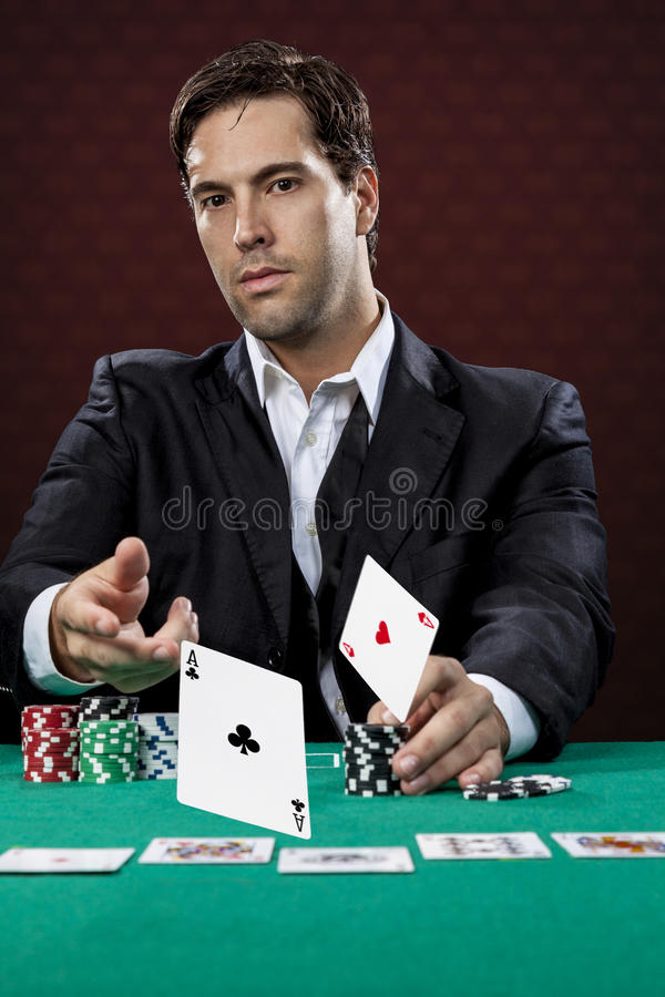 Poker player. On a red background, throwing two ace cards stock photos
