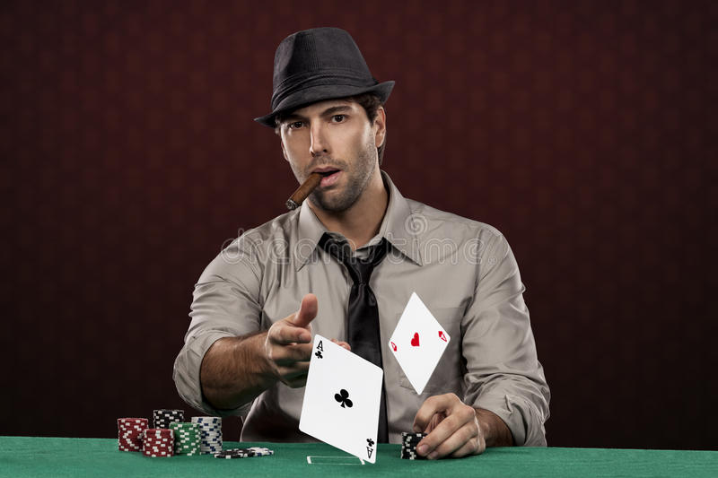 Poker player. On a red background, throwing two ace cards stock images