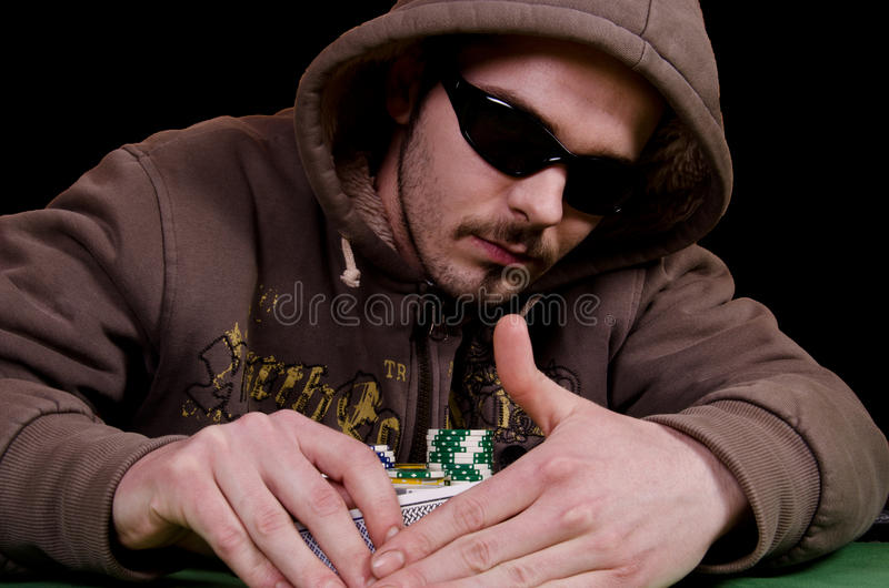 Poker player. Is looking the cards royalty free stock image