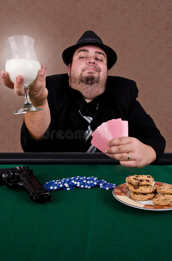 Poker player. Holding a glass of milk, close up royalty free stock photography