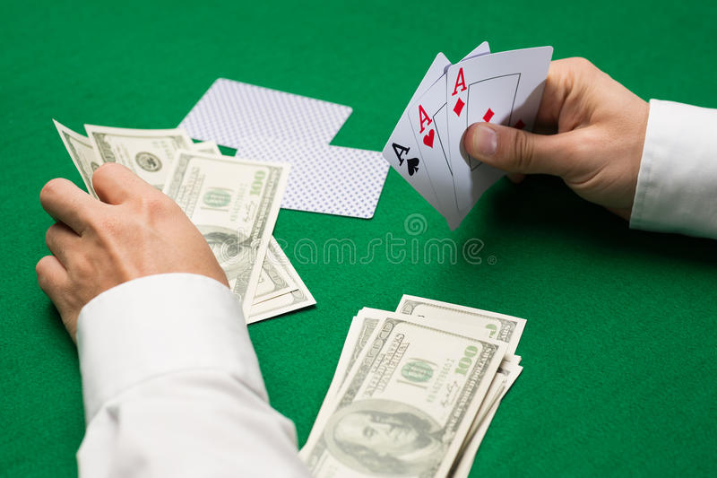 Poker player with cards and money at casino royalty free stock image