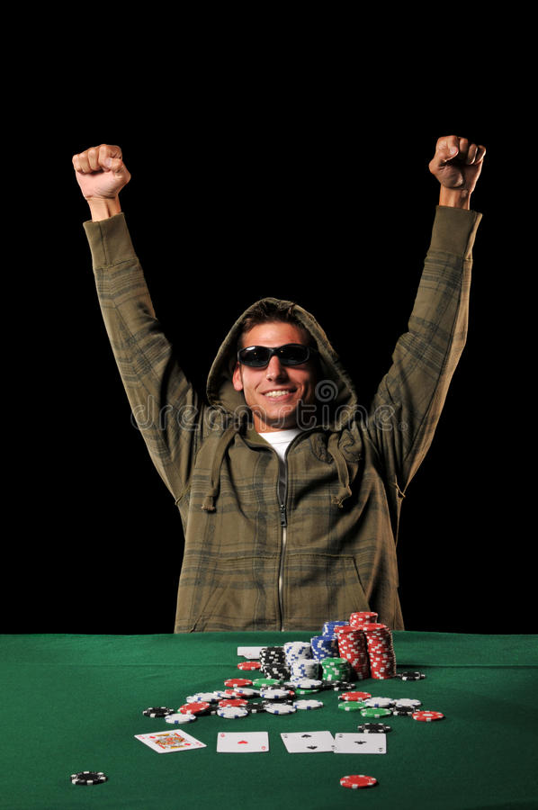 Poker player celebrating. With extended arms isolated on a black background royalty free stock photography
