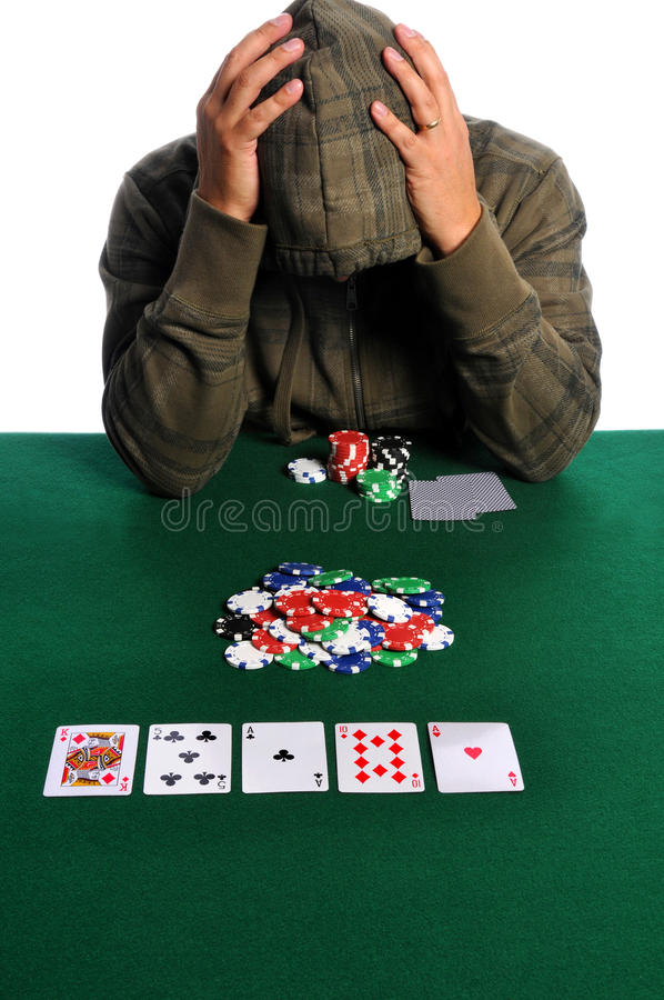 Poker Player in Despair. Poker player holding head in despair stock image
